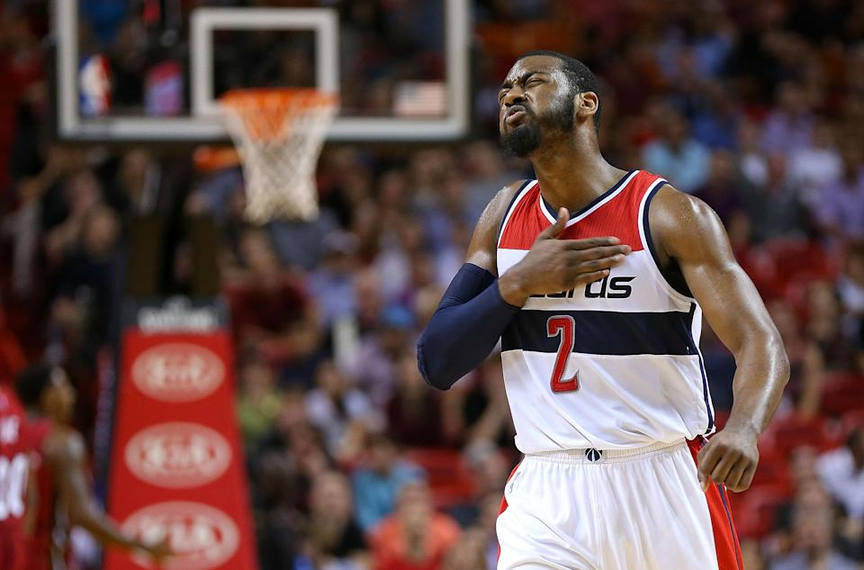 John Wall #2 of the Washington Wizards reacts during a game against the Miami Heat on December 19, 2014 in Miami, Florida (AFP Photo/Mike Ehrmann)