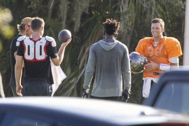 Tom Brady gets some reps in with his teammates on June 23 at Berkeley Preparatory School in Tampa, Fla. (Chris Urso/Tampa Bay Times via AP)