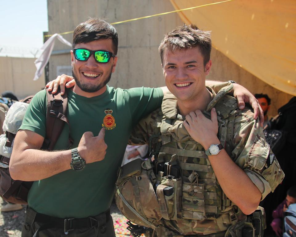 Mohammed Jawad Akbari with Captain David Kellett after being reunited in Kabul (Ministry of Defence)