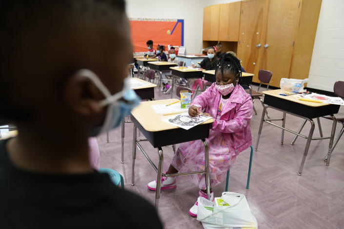 A student colors in a classroom at Tussahaw Elementary school on Wednesday, Aug. 4, 2021, in McDonough, Ga. Schools have begun reopening in the U.S. with most states leaving it up to local schools to decide whether to require masks. (AP Photo/Brynn Anderson)