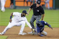 Detroit Tigers shortstop Niko Goodrum, left, tags out Seattle Mariners' Taylor Trammell trying to steal second base during the sixth inning of a baseball game Wednesday, June 9, 2021, in Detroit. (AP Photo/Duane Burleson)