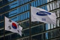 A flag bearing the logo of Samsung flutters in front of its office building in Seoul