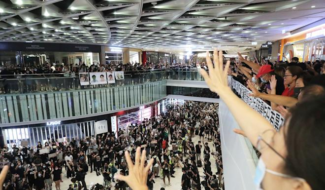 Anti-government protesters sing during a protest at the Yoho Mall in Yuen Long. Photo: Edmond So
