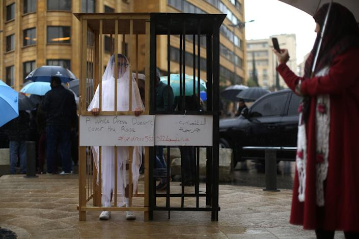 An activist from Abaad, a women's rights group in Lebanon, protests a law that shields rapists from prosecution on the condition that they marry their victim. (Photo: PATRICK BAZ via Getty Images)