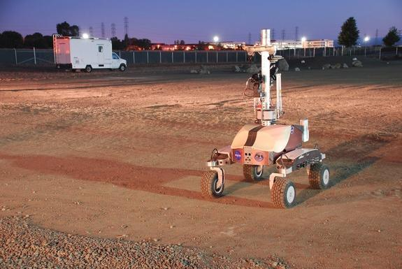 """NASA's K10 rover is seen at dawn at the Ames Research Center specially built """"Roverscape"""" in Moffett Field, Calif. The rover was remote controlled by an astronaut on the International Space Station during a June 2013 technology test."""