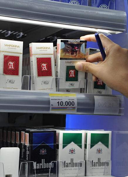 A rack of cigarette packs in the Indonesian capital Jakarta includes local brands carrying graphic health warnings (AFP Photo/Romeo Gacad)