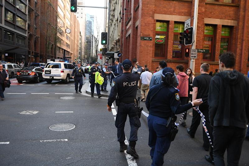Police are seen during a police operation at the corner of King and York Street in Sydney, Tuesday, August 13, 2019. A police operation is underway in Sydney's CBD with multiple police, fire and ambulance vehicles racing to the scene amid reports of a stabbing. (AAP Image/Dean Lewins) NO ARCHIVING