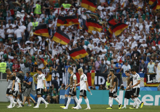 German players walk off the pitch after losing 0-1 against Mexico in their group F match at the 2018 soccer World Cup in the Luzhniki Stadium in Moscow, Russia, Sunday, June 17, 2018. (AP Photo/Eduardo Verdugo)