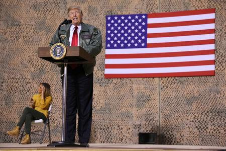 U.S. President Donald Trump delivers remarks to U.S. troops in an unannounced visit to Al Asad Air Base, Iraq December 26, 2018. REUTERS/Jonathan Ernst