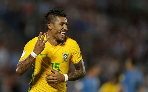 Paulinho celebrates his hat trick during a 2018 World Cup qualifying soccer match against Uruguay in Montevideo, Uruguay, Thursday, March. 23, 2017 - Credit: Natacha Pisarenko/AP