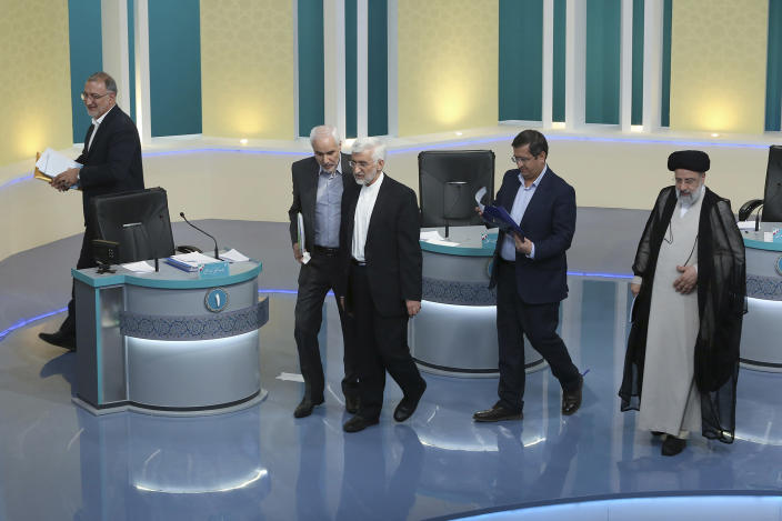 FILE - In this Saturday, June 12, 2021 file photo made available by Young Journalists Club, YJC, presidential candidates for June 18, elections Alireza Zakani, left, Mohsen Mehralizadeh, second left, Saeed Jalili, center, Abdolnasser Hemmati, second right, and Ebrahim Raisi leave at the conclusion of a part of the final debate of the candidates at a state-run TV studio in Tehran, Iran. The presidential election is likely to be a coronation for Raisi, a hard-line candidate long cultivated by Supreme Leader Ayatollah Ali Khamenei. (Morteza Fakhri Nezhad/ Young Journalists Club, YJC via AP, File)