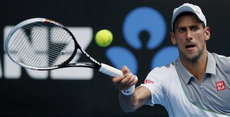 Novak Djokovic of Serbia hits a return to Leonardo Mayer of Argentina during their men's singles match at the Australian Open 2014 tennis tournament in Melbourne January 15, 2014. REUTERS/Jason Reed