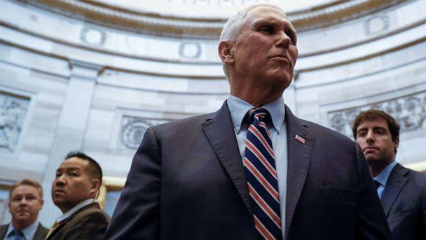 PHOTO: Vice President Mike Pence talks with Capitol visitors after he attended the weekly Republican Senate policy luncheon on Capitol Hill in Washington, Dec. 17, 2019. (Tom Brenner/Reuters, FILE)