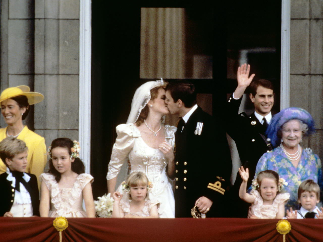 <p>Sarah Ferguson tied the knot with her ex-husband, the Duke of York, on 23 July 2986 at Westminster Abbey. Her 80s gown was typical of the flamboyant styles popular then and was copied across the world afterwards. It was designer by Lindka Cierach and made from ivory duchesse satin. Some 2,000 guests attended the ceremony, including Prime Minister Margaret Thatcher and US First Lady Nancy Reagan. <em>[Photo: PA Images]</em> </p>