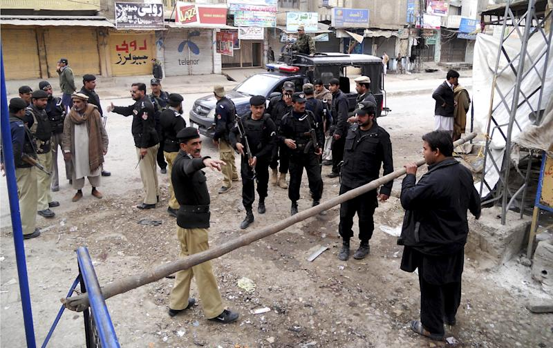Pakistani police commandos cordon off an area following a blast in Hangu, Pakistan on Friday, Feb 1, 2013. A suicide bomber detonated his explosives outside a Shiite mosque in northwestern Pakistan as worshippers were leaving Friday prayers, killing several people and wounding many in the latest apparent sectarian attack in the country, police said. (AP Photo/Abdul Basit)