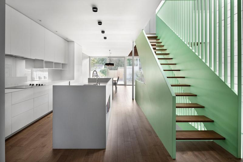 This gorgeous mint green staircase is undoubtedly the focal point of the Victoria Residence's renovated interiors.