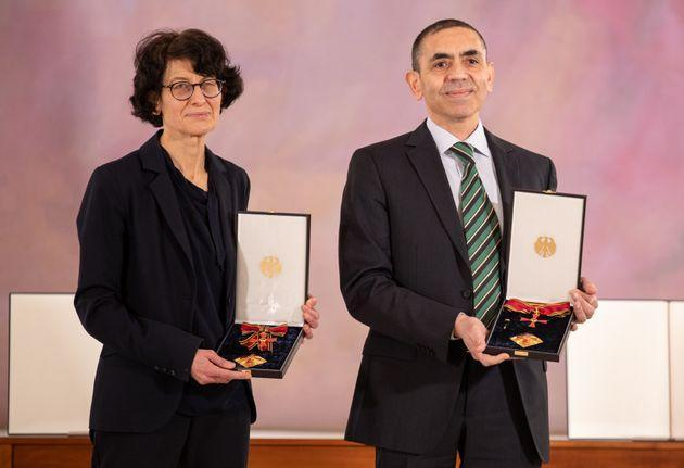 BERLIN, GERMANY - MARCH 19: Oezlem Tuereci and Ugur Sahin, founders of Biontech SE, pose after receiving the Federal Order Of Merit from President Frank-Walter Steinmeier at Schloss Bellevue on March 19, 2021 in Berlin, Germany.  (Photo by Andreas Gora - Pool/Getty Images) (Photo: Pool via Getty Images)