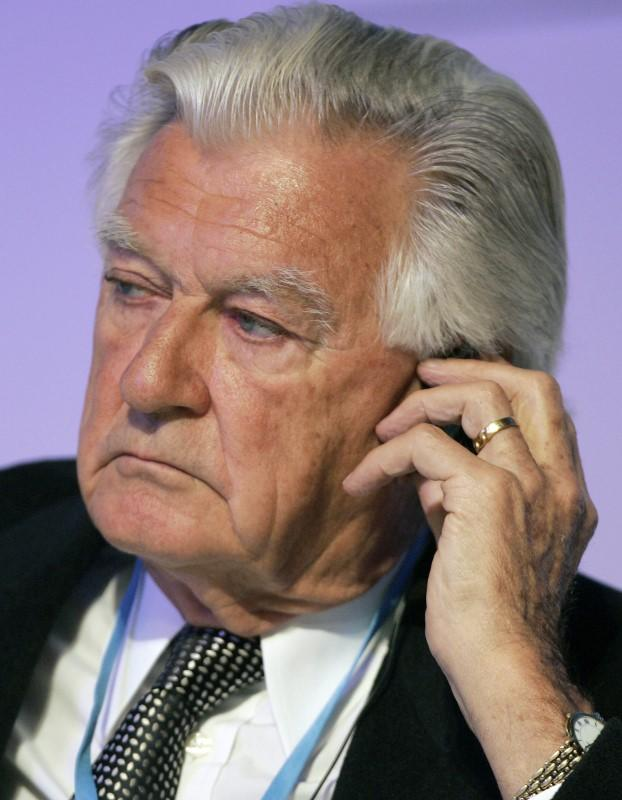 Former Australian Prime Minister Bob Hawke listens to a speaker during a session at the World Leaders Forum for commemorating the 60th anniversary of South Korea at a hotel in Seoul