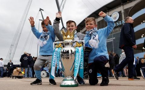 City fans with the trophy - Credit: Reuters
