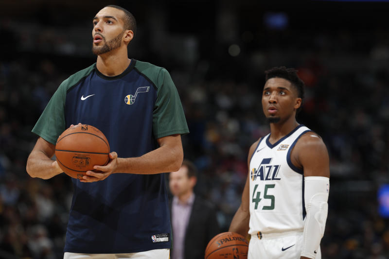Utah Jazz center Rudy Gobert (27) and Utah Jazz guard Donovan Mitchell (45) in the second half of an NBA basketball game Saturday, Nov. 3, 2018, in Denver. The Nuggets won 103-88. (AP Photo/David Zalubowski)