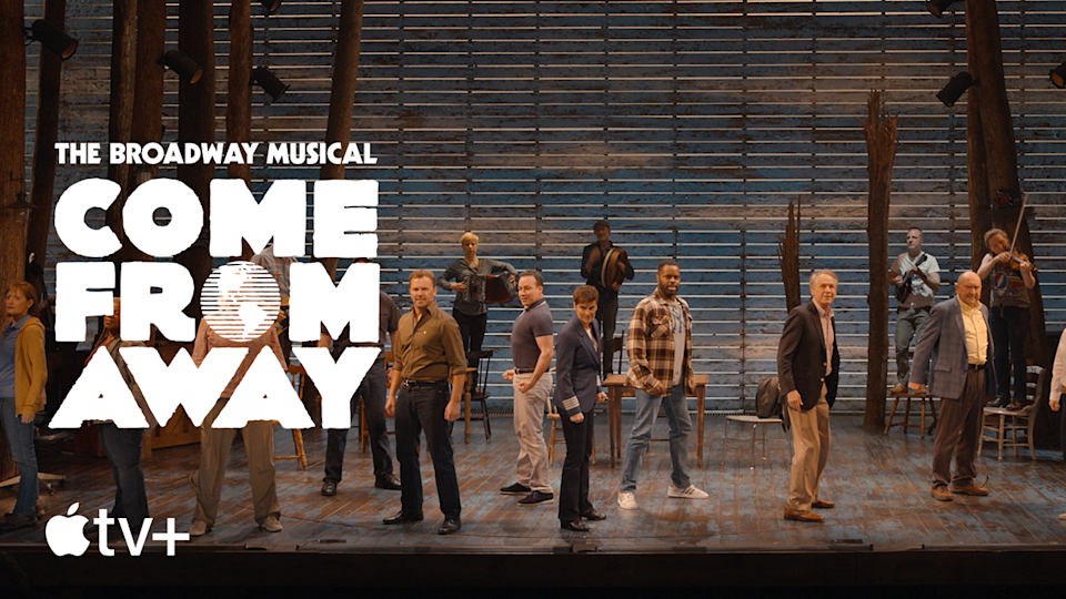 Cast of Come From Away performs on stage. Image via Apple TV+