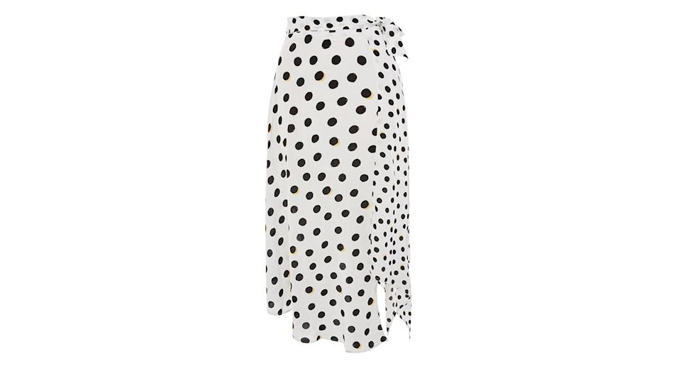 """<p>This wrap polka dot skirt is a great, transitional piece. Pair it with a chunky knit now and wear it again in the summer with a simple tee. <a rel=""""nofollow noopener"""" href=""""http://topshop.com"""" target=""""_blank"""" data-ylk=""""slk:Buy here."""" class=""""link rapid-noclick-resp""""><em>Buy here.</em></a> </p>"""