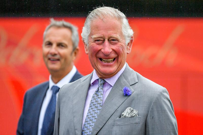 ABERCYNON, UNITED KINGDOM - JULY 13: Prince Charles, Prince of Wales reacts to a joke as he meets members of staff during a visit to family run travel and holiday business, Edwards Coaches on July 13, 2020 in Abercynon, near Mountain Ash, South Wales. The company has been impacted by the pandemic, but are now beginning to restart some of their operations. (Photo by Ben Birchall-WPA Pool/Getty Images)