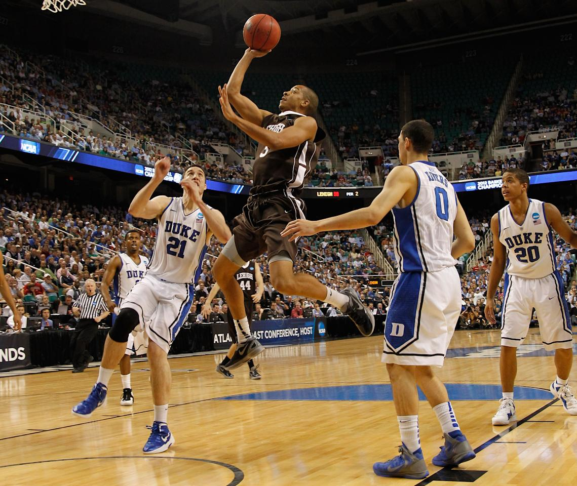 GREENSBORO, NC - MARCH 16:  C.J. McCollum #3 of the Lehigh Mountain Hawks shoots over Miles Plumlee #21 of the Duke Blue Devils and is fouled in the second half during the second round of the 2012 NCAA Men's Basketball Tournament at Greensboro Coliseum on March 16, 2012 in Greensboro, North Carolina.  (Photo by Mike Ehrmann/Getty Images)
