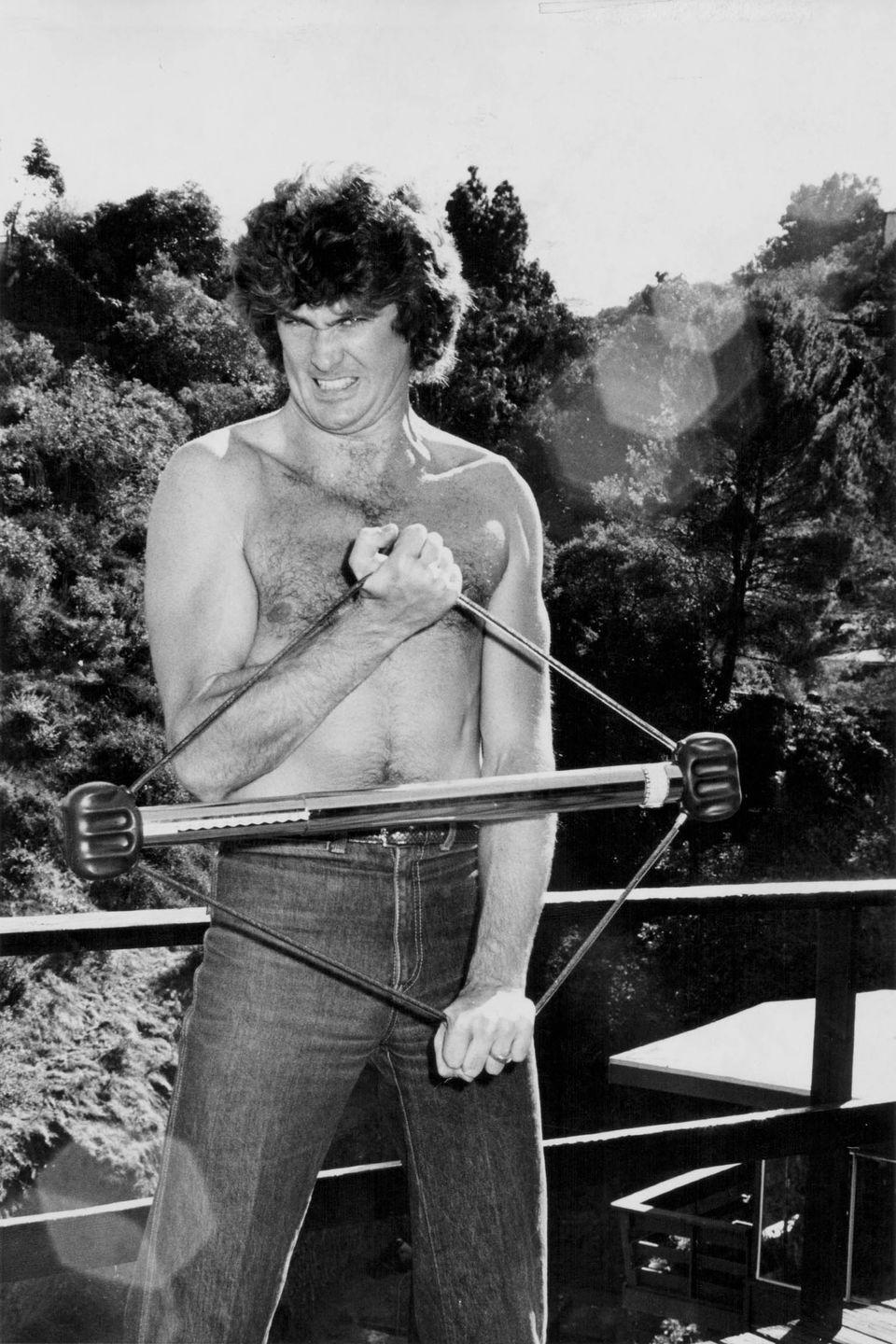 <p>David Hasselhoff jokingly practicing body building exercises, at his home in the Hollywood Hills in 1979.</p>