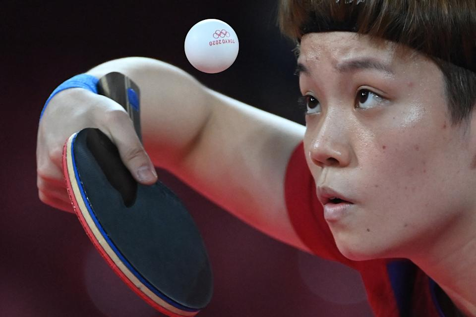 <p>Hong Kong's Doo Hoi-kem competes during their women's team round of 16 table tennis match at the Tokyo Metropolitan Gymnasium during the Tokyo 2020 Olympic Games in Tokyo on August 1, 2021. (Photo by ADEK BERRY / AFP)</p>