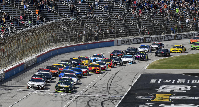 Kevin Harvick (4) leads the field for the start of a NASCAR auto race at Texas Motor Speedway, Sunday, Nov. 3, 2019, in Fort Worth, Texas. (AP Photo/Larry Papke)