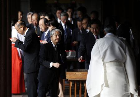 A group of lawmakers walk after paying their respects to the war dead at Yasukuni Shrine in Tokyo