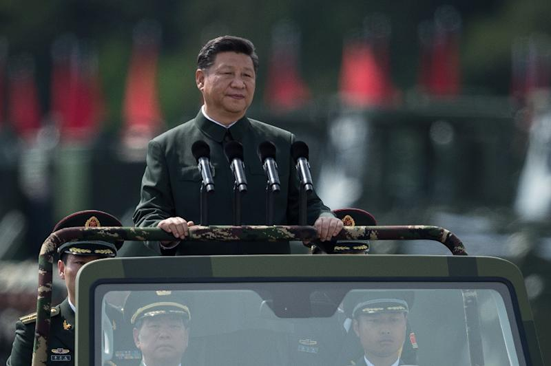 """China's President Xi Jinping says the People's Liberation Army must """"unswervingly stick to... the (Communist) Party's absolute leadership"""" and """"march to wherever the Party is pointing"""" (AFP Photo/DALE DE LA REY)"""