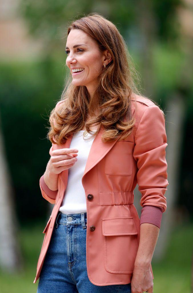 <p>A peachy shade of pink lends feminine flare to the utilitarian jacket Kate Middleton wore to visits the 'Urban Nature Project' at The Natural History Museum in London.</p>