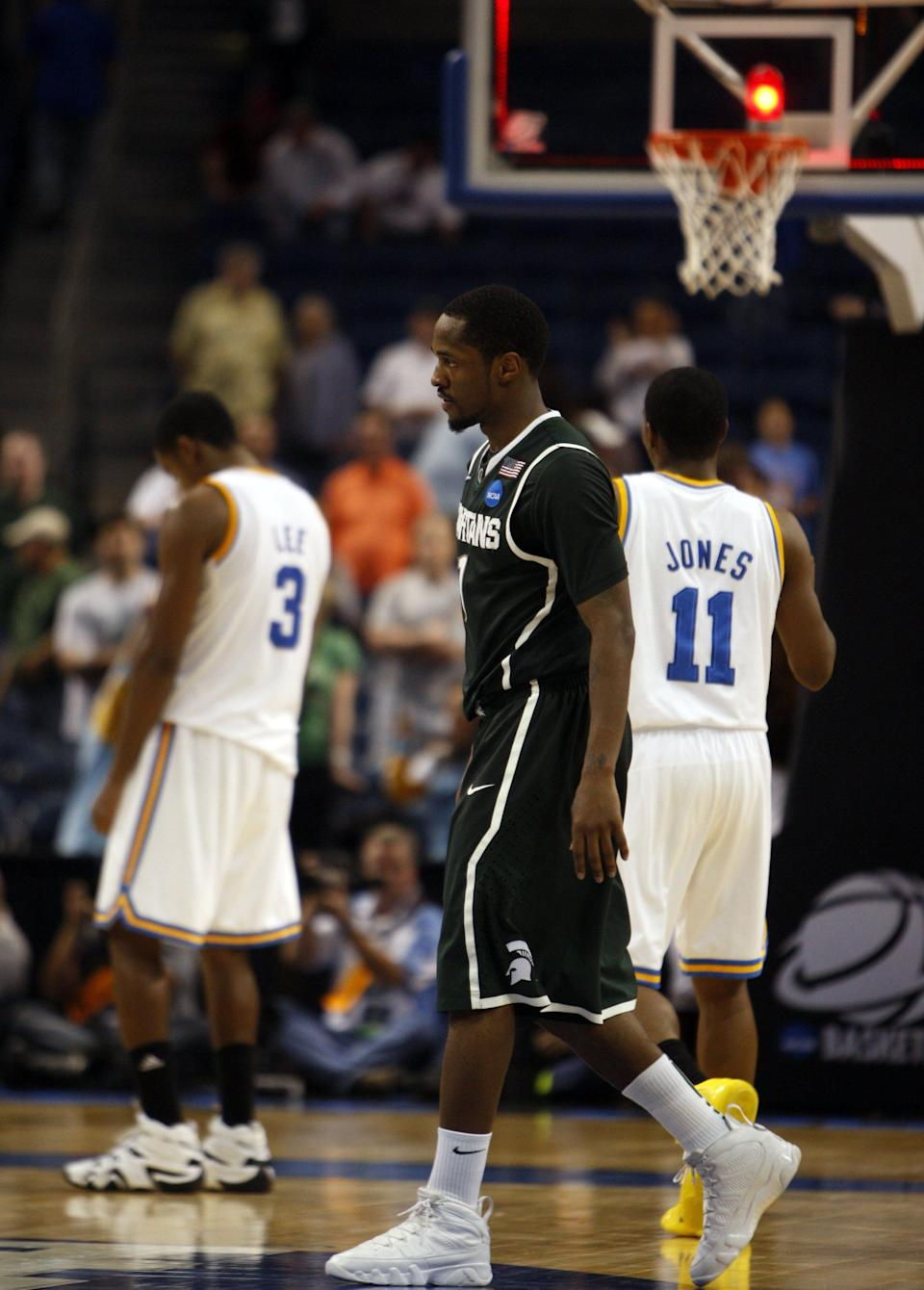 Michigan State's Kalin Lucas walks off the court after being called for traveling at the end of the 78-76 loss to UCLA in the of NCAA tournament on March 17, 2011, at the St. Pete Times Forum.