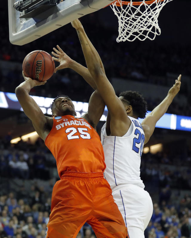 Syracuse's Tyus Battle (25) heads to the basket as Duke's Marques Bolden (20) defends during the second half of a regional semifinal game in the NCAA men's college basketball tournament Friday, March 23, 2018, in Omaha, Neb. (AP Photo/Charlie Neibergall)