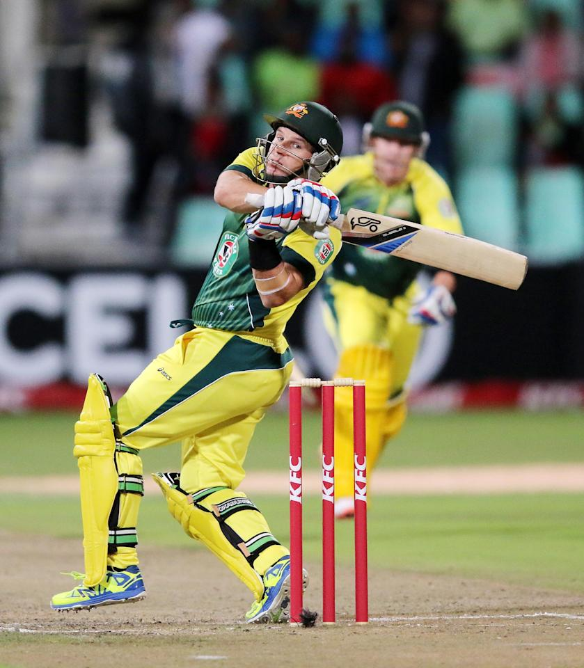 DURBAN, SOUTH AFRICA - MARCH 12: Brad Hodge of australia hits the winning runs   during the 2nd KFC T20 International match between South Africa and Australia at Sahara Stadium Kingsmead on March 12, 2014 in Durban, South Africa. (Photo by Anesh Debiky/Gallo Images/Getty Images)