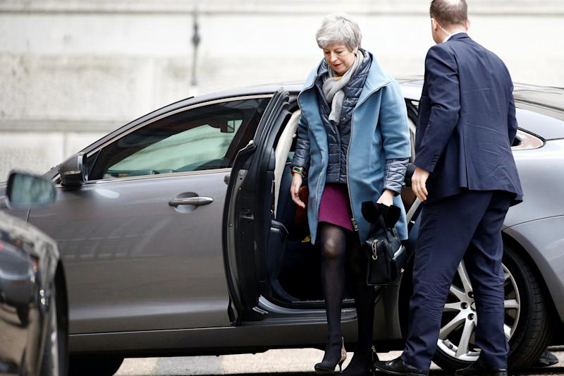 Pressure: Theresa May in Downing Street today after being driven back from RAF Northolt in the early hours following the summit (REUTERS)