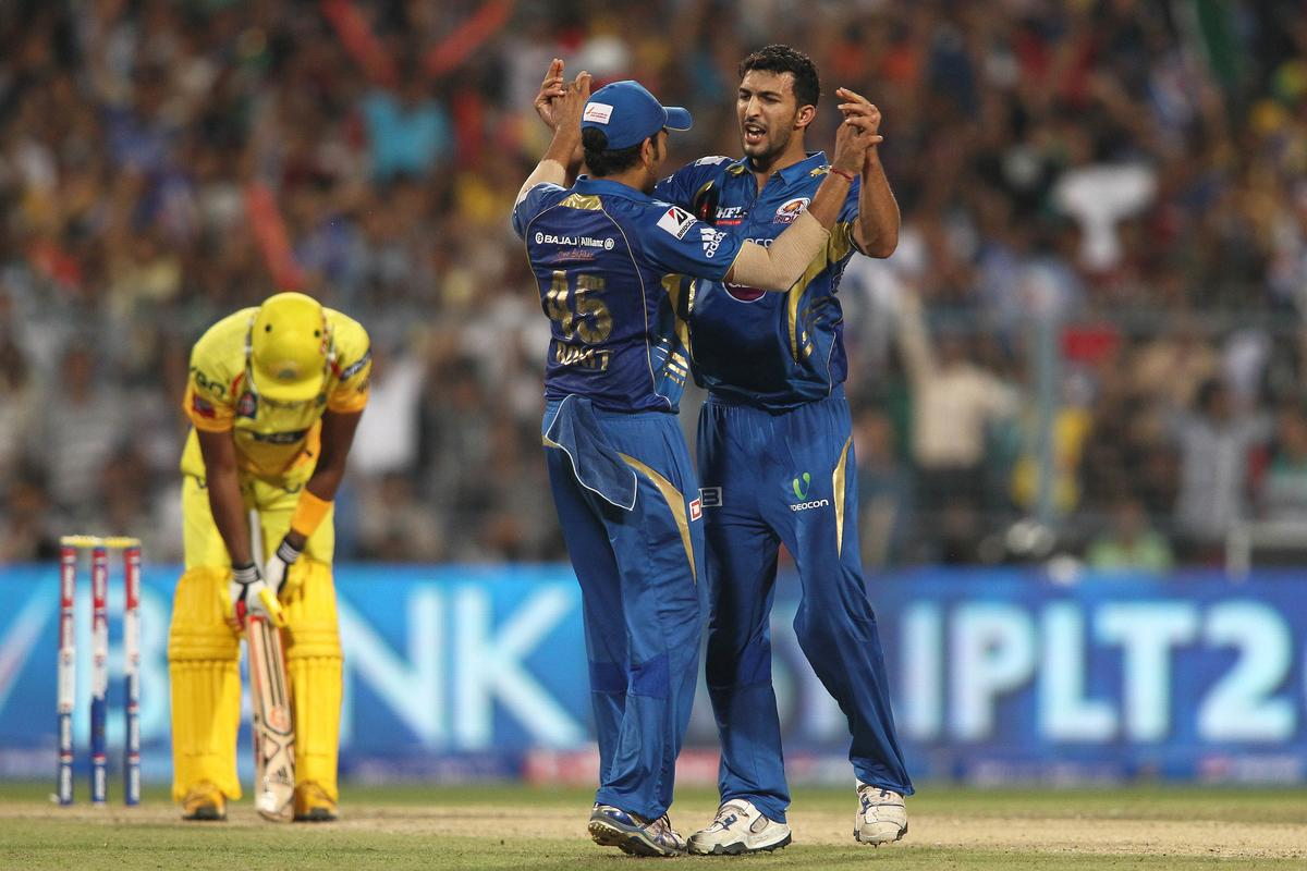 Mumbai Indians captain Rohit Sharma congratulates Rishi Dhawan of Mumbai Indians for getting Dwayne Bravo of Chennai Super Kings wicket during the Final of the Pepsi Indian Premier League between The Chennai Superkings and the Mumbai Indians held at the Eden Gardens Stadium in Kolkata on the 26th May 2013..Photo by Saikat Das-IPL-SPORTZPICS       ..Use of this image is subject to the terms and conditions as outlined by the BCCI. These terms can be found by following this link:..https://ec.yimg.com/ec?url=http%3a%2f%2fwww.sportzpics.co.za%2fimage%2fI0000SoRagM2cIEc&t=1506398500&sig=BKZJbKVTnnq.JMrEQUdXkw--~D