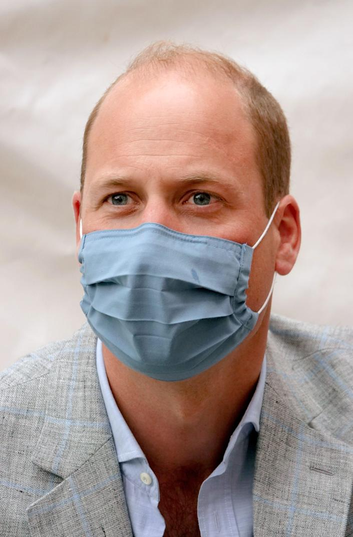 William wore a blue mask, co-ordinating with his outfit. (Getty Images)