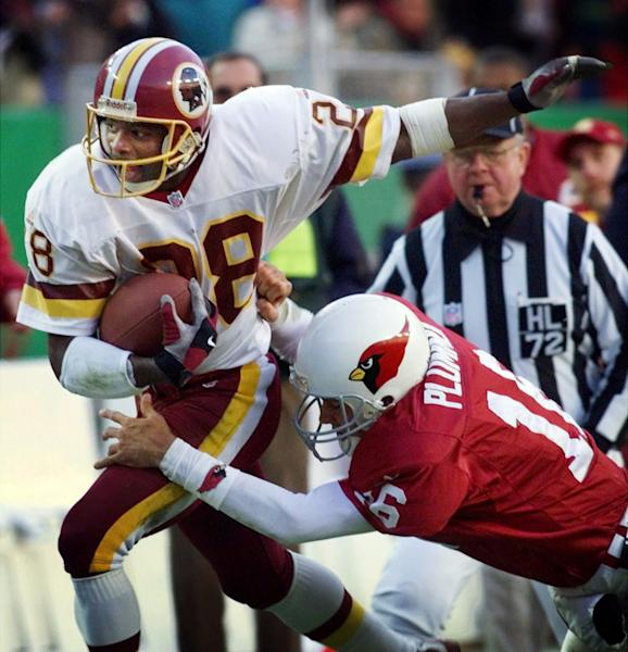"FILE - In this Dec. 12, 1999, file photo, Arizona Cardinals quarterback Jake Plummer (16) tries to tackle Washington Redskins cornerback Darrell Green (28) who intercepted Plummer's pass during the fourth quarter of an NFL football game at FedEx Field in Landover, Md. The former Washington Redskins cornerback, elected to the Pro Football Hall of Fame in 2008, looks around today's NFL and sees a lack of talent at his old job. ""I would say this: The cornerback position is probably at its lowest level. (AP Photo/Doug Mills, File)"