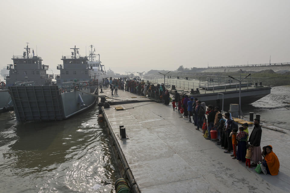 Rohingya refugees headed to the Bhasan Char island line up to board navy vessels from the south eastern port city of Chattogram, Bangladesh, Monday, Feb.15,2021. Authorities sent a fourth group of Rohingya refugees to the newly developed island in the Bay of Bengal on Monday amid calls by human rights groups for a halt to the process. (AP Photo)