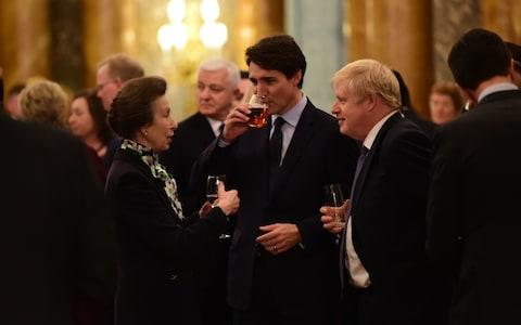 <span>Princess Anne chats with Justin Trudeau and Boris Johnson at Buckingham Palace</span> <span>Credit: Geoff Pugh for the Telegraph </span>