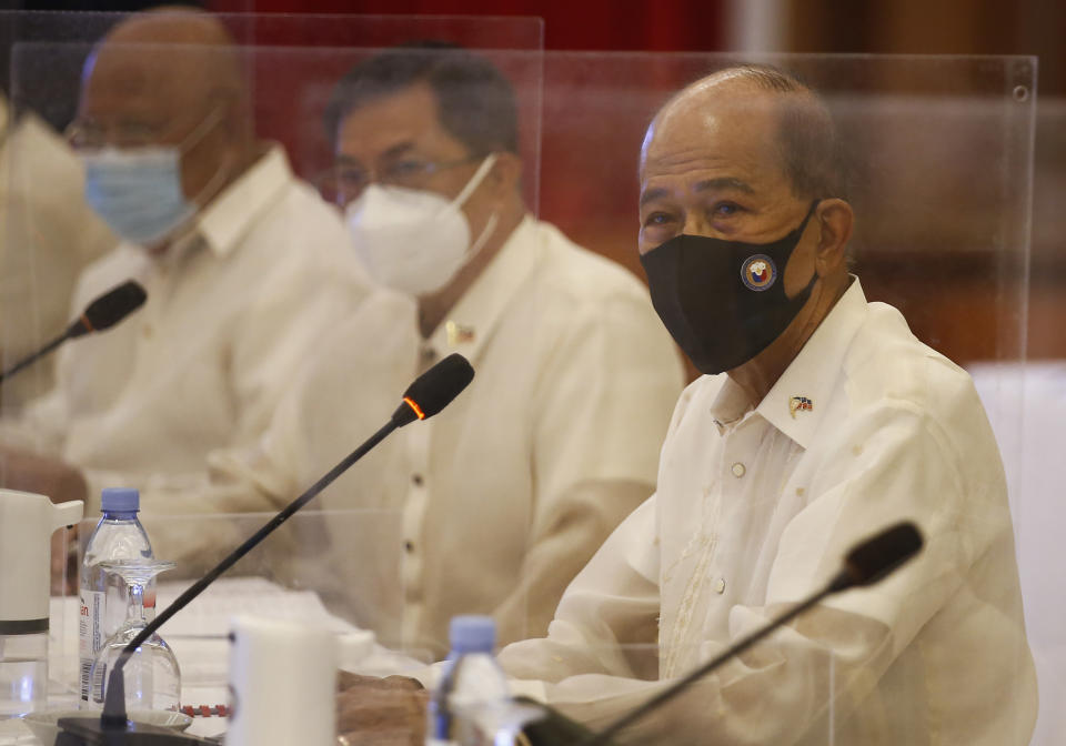 Philippines Defense Secretary Delfin Lorenzana, right, leads his delegation in a bilateral meeting with US counterparts led by U.S. Defense Secretary Lloyd Austin at Camp Aguinaldo military camp in Quezon City, Metro Manila, Philippines Friday, July 30, 2021. Austin is visiting Manila to hold talks with Philippine officials to boost defense ties and possibly discuss the The Visiting Forces Agreement between the US and Philippines. (Rolex dela Pena/Pool Photo via AP)