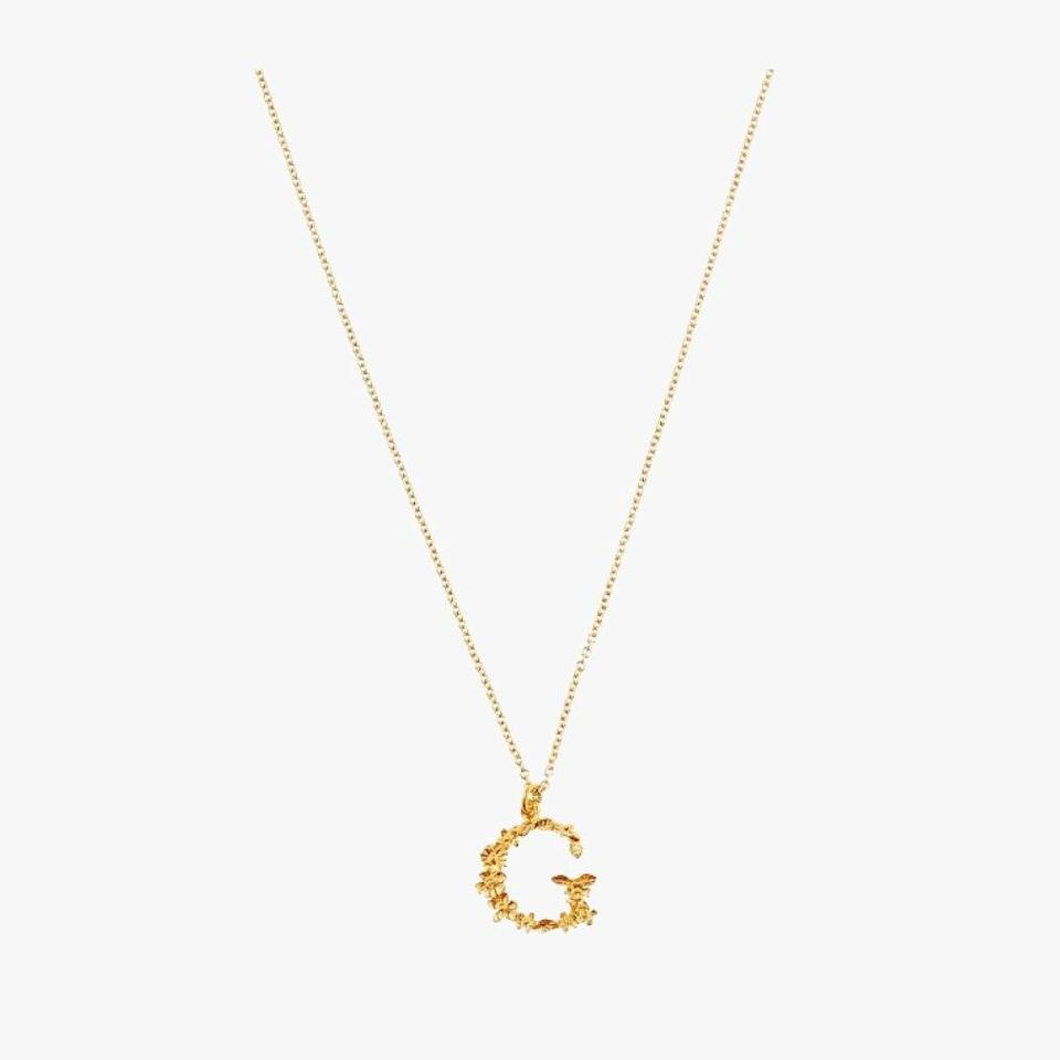 "$190, LIBERTY. <a href=""https://www.libertylondon.com/us/gold-plated-floral-letter-g-alphabet-necklace-R219151006.html#pos=45"" rel=""nofollow noopener"" target=""_blank"" data-ylk=""slk:Get it now!"" class=""link rapid-noclick-resp"">Get it now!</a>"