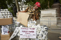 Anti-Trump protestors sell Donald Trump toilet paper in Parliament Square outside Westminster on June 4, 2019 in London. (Photo By Alex McBride/Getty Images)
