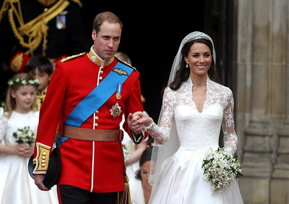 Prince William and his wife Catherine, Duchess of Cambridge emerge from Westminster Abbey after the wedding ceremony.   (Photo by Lewis Whyld/PA Images via Getty Images)