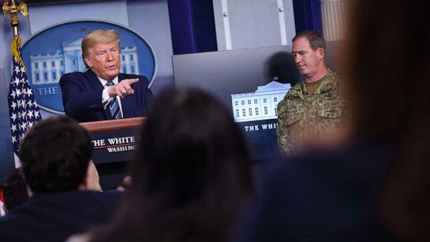 PHOTO: US President Donald Trump speaks as FEMA's supply chain task force lead Navy Rear Adm. John Polowczyk listens during an unscheduled briefing after a Coronavirus Task Force meeting at the White House on April 5, 2020, in Washington, DC. (Eric Baradat/AFP via Getty Images)