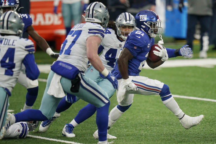 New York Giants' Jabrill Peppers, right, returns a punt during the first half of an NFL football game against the Dallas Cowboys, Sunday, Jan. 3, 2021, in East Rutherford, N.J. (AP Photo/Frank Franklin II)