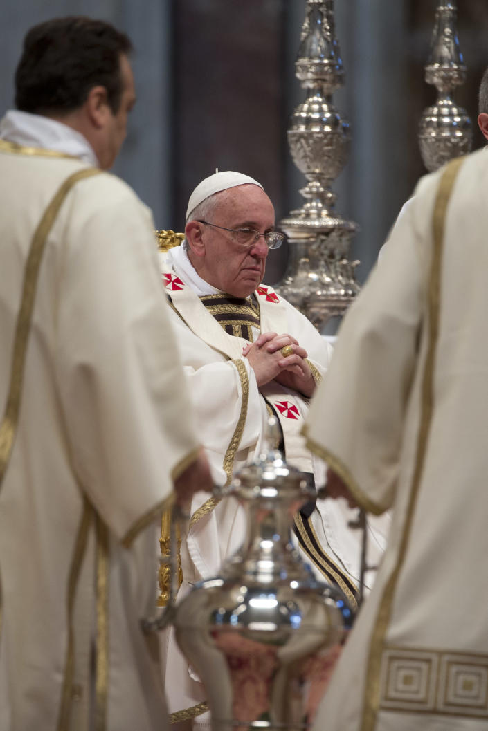 An amphora containing holy oil is brought before Pope Francis during the Chrism Mass in St. Peter's Basilica at the Vatican, Thursday, April 17, 2014. During the mass the Pontiff blesses a token amount of oil that will be used to administer the sacraments throughout the year. The Chrism Mass marks the start of the Easter celebrations. (AP Photo/Andrew Medichini)